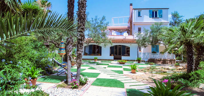 panoramic photo of the garden and villa solaris apartments holidays